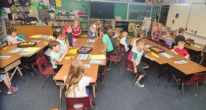 To their seats for the first day of school in kindergarten at Taylor Hicks Elementary School in Prescott Thursday, Aug. 1, 2019. (Les Stukenberg/Courier, file)