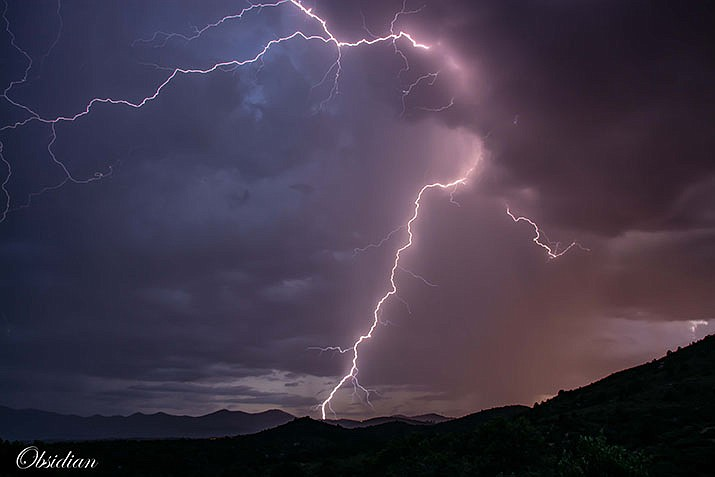 Lightning touches down west of Thumb Butte during a monsoon storm on Sunday, Aug. 4, 2019. Prescott National Forest officials are monitoring three recent fires caused by lightning. (Obsidian DeLeau/Courtesy photo)
