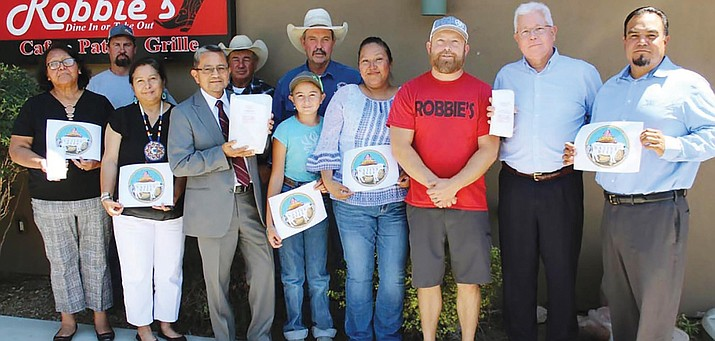 On July 18, the Yavapai-Apache Nation Agriculture Program officially launched its tribally owned and operated Native Beef Brand during a joint luncheon with Robbie's Restaurant in Rimrock. Pictured, back row, from left: Bill Moore, Barry Brashears and Dusty Trammel of YAN Agriculture. Front row, from left: YAN council members Nancy Guzman, Genevieve Datsi and Larry Jackson; Sage Trammel; YAN Agriculture Manager Yolanda Trujillo; Robbie Satran, owner of Robbie's Restaurant; Anthony Canty and YAN council member Henry Smith. Photo courtesy Yavapai-Apache Nation