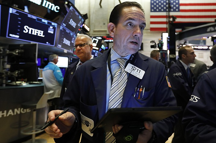 In this Aug. 6, 2019, file photo trader Tommy Kalikas works on the floor of the New York Stock Exchange. This past week was a wild one for the U.S. stock market. (Richard Drew/AP, File)