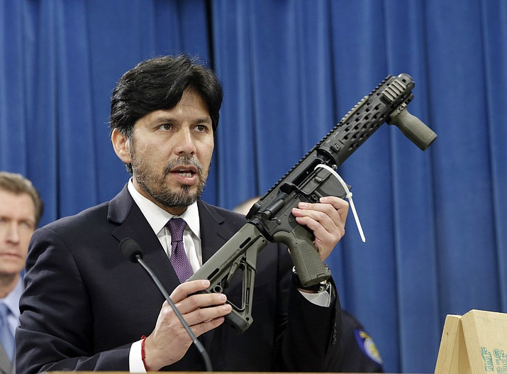 In this Jan. 13, 2014 file photo, former California State Sen. Kevin de Leon, D-Los Angeles, displays a homemade fully automatic rifle, confiscated by the Department of Justice, at the Capitol in Sacramento, Calif. California is among a handful of states taking tough actions to limit the availability of guns including military-style assault weapons, restrict the capacity of ammunition magazines and require background checks for purchasing bullets. But those steps and future gun control laws passed by Democratic-leaning states could face an uphill battle as the federal court system becomes increasingly dominated by conservative Republican appointees.(Rich Pedroncelli/AP, File)