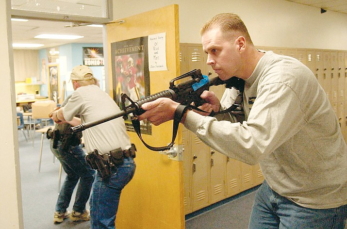 "Members of the Prescott Police Department practice a drill for an ""active shooter"" in August 2005 at Prescott High School. (Courier file photo)"