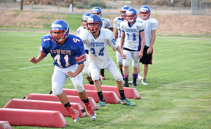 Camp Verde Cowboys shuffle around agility dummies at practice on Friday afternoon. VVN/James Kelley