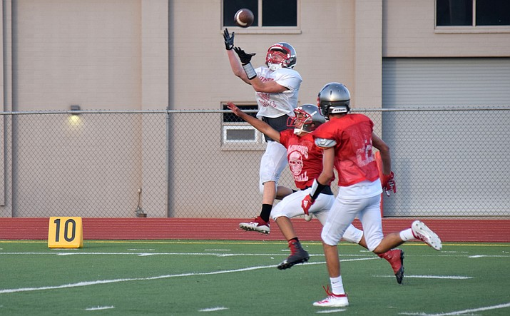 Mingus junior Andrew Nahar catches a long touchdown pass during the Marauders' Red and Gray Scrimmage on Friday night. VVN/James Kelley