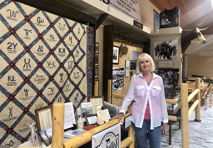 Marilyn Fisher, whose career included decades of curating the artifacts of former President Ronald Reagan, recently retired to Prescott. She now volunteers as a curator at Prescott's new Western Heritage Center on Whiskey Row. (Cindy Barks/Courier)