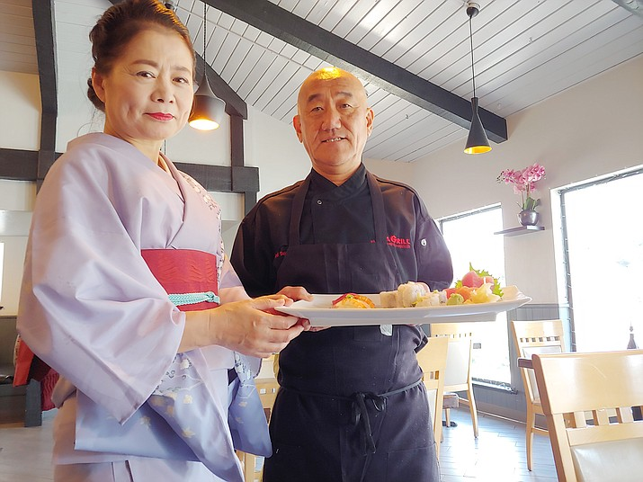 Japanese sushi Chef Ken Homan, shown here inside the dining room of his Sushi Man restaurant with his wife, Yuri, serves fresh fish six days a week at 1355 Iron Springs Road in Prescott.
