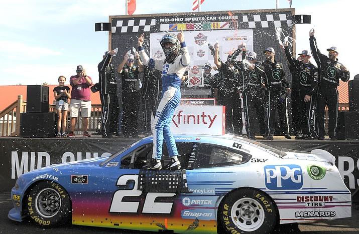 Austin Cindric celebrates after winning the NASCAR Xfinity Series Saturday, Aug. 10, 2019, at Mid-Ohio Sports Car Course in Lexington, Ohio. (AP Photo/Tom E. Puskar)