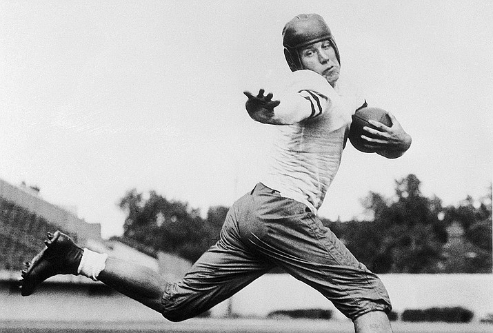 In this 1934 photo, University of Chicago halfback Jay Berwanger is shown in the action pose that served as the model for the Heisman Trophy. In the early days of the NFL, college football was king and playing the game professionally was not necessarily something players aspired to do. (AP Photo/File)