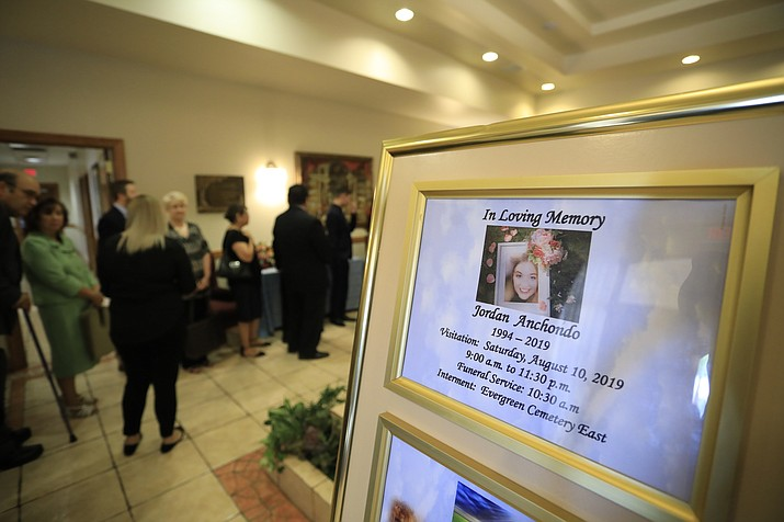 Mourners gather to attend the visitation services for Jordan Anchondo at San Jose Funeral Home in El Paso, Texas on Saturday, Aug. 10, 2019.   Andre and Jordan Anchondo, were among the several people killed last Saturday, when a gunman opened fire inside a Walmart packed with shoppers. Authorities say Jordan Anchondo was shielding the baby, while her husband shielded them both.  (AP Photo/Jorge Salgado)