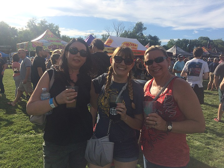 Michelle Haiser, Janet Bernard and Nicole Anderson enjoy some brews at the eighth annual Mile High Brewfest at Prescott Mile High Middle School Saturday, Aug. 10. (Jason Wheeler/Courier)