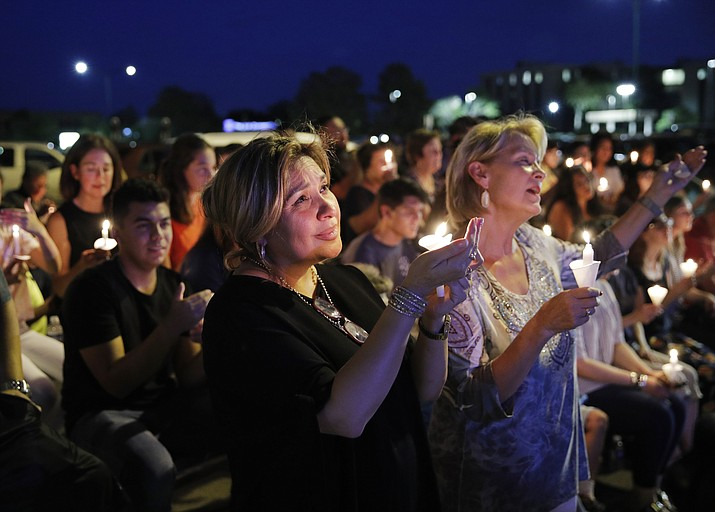 "People attend a candlelight vigil for victims of a mass shooting Aug. 5, 2019, in El Paso, Texas. Join the Prescott community for ""Candlelight Vigil – Unite Through Light!"" at 7 p.m. Monday, Aug. 12, at the Yavapai County Courthouse Plaza. Meet at Buckey's statue to join together to collectively mourn the tragedy of all of those directly and indirectly impacted by the recent shootings in Dayton and El Paso. Prescott joins with other communities concerned for the soul of the country, and will come together in rain or shine, wearing dark colors, with a light (battery votives or cellphone), and an umbrella in case of inclement weather. Hosted by Prescott Peacebuilders, Prescott Indivisible, and people of all faiths. (John Locher/AP)"