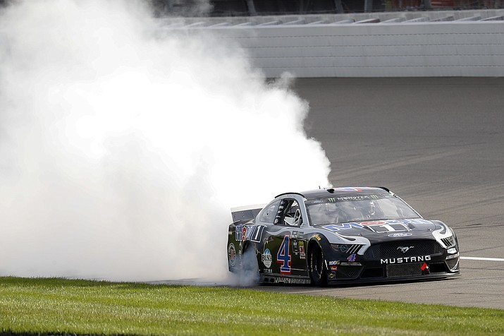 Kevin Harvick celebrates after winning a NASCAR Cup Series auto race at Michigan International Speedway in Brooklyn, Mich., Sunday, Aug. 11, 2019. (Paul Sancya/AP)