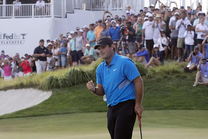 Patrick Reed pumps his fist on the 18th hole as he wins on the Northern Trust golf tournament at Liberty National Golf Course, Sunday, Aug. 11, 2019, in Jersey City, N.J. (Mark Lennihan/AP)