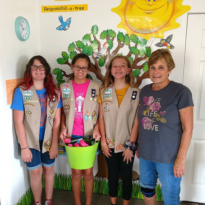 "Chino Valley Cadettes Tayen Parker, Emma Shearer and Ashley Morrow from Girl Scout Troop 449 have completed their Silver Award. They donated over 150 ""Wisper Phones,"" which they hand made, to Territorial Elementary, Paulden Community and Mingus Springs Charter schools. (Courtesy)"