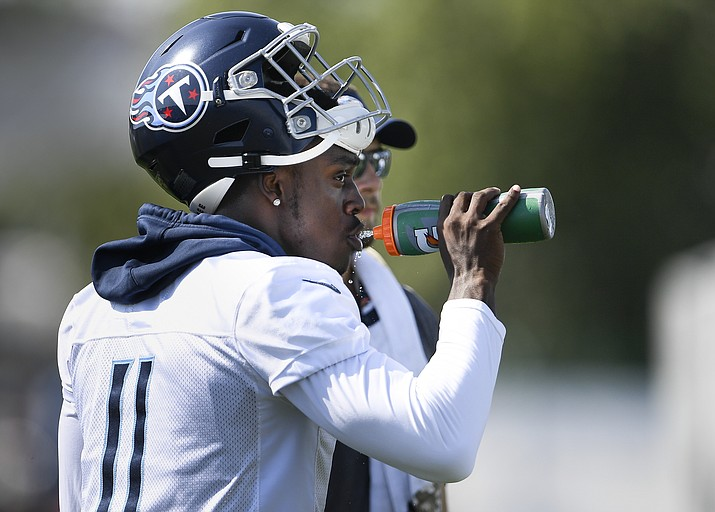 Tennessee Titans wide receiver A.J. Brown (11) drinks water during NFL football practice at Saint Thomas Sports Park, Sunday, Aug. 11, 2019, in Nashville, Tenn. (George Walker IV/The Tennessean via AP)