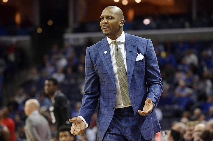 In this Feb. 7, 2019, file photo, Memphis head coach Penny Hardaway watches during an NCAA college basketball game against Cincinnati in Memphis, Tenn. Former NBA stars Hardaway and Jerry Stackhouse have taken on new challenges with both trying to revive a pair of struggling college basketball programs about 200 miles apart in Tennessee. Hardaway played for the Phoenix Suns (1999-2004). (Brandon Dill/AP, File)