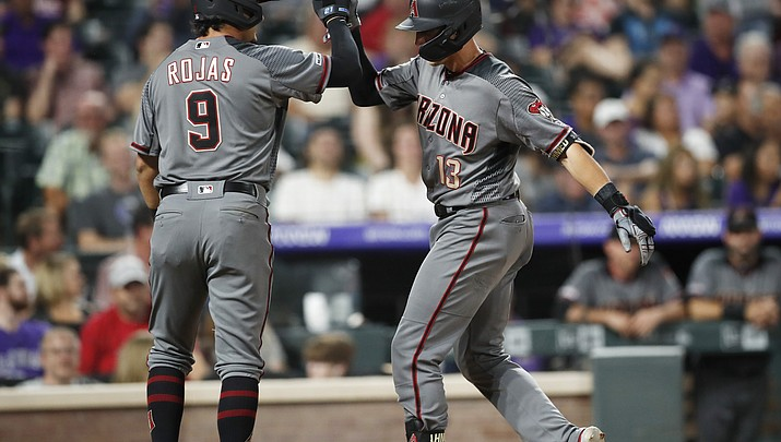 Diamondbacks use 3 homers in 6th to rally past Rockies