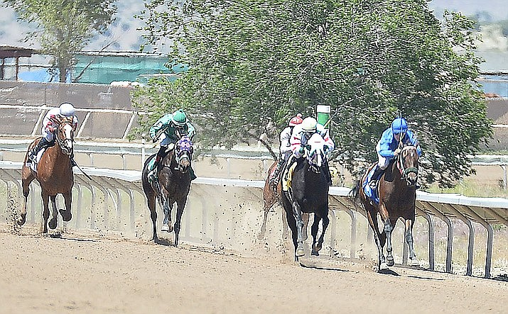 Horses race down the stretch at Arizona Downs on Friday, May 24, 2019, in Prescott Valley. After being closed for 10 years, the racetrack faces a hurdle in a newly filed lawsuit over off-track betting. (Les Stukenberg/Courier, file)