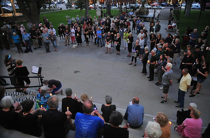 Several hundred people gather on the Yavapai County Courthouse Plaza, Monday, Aug. 12, 2019, for the Prescott Indivisible and Prescott Peacebuilders candlelight vigil honoring the Dayton and El Paso shooting victims. Similar vigils have been held across the country in the past few days. (Les Stukenberg/Courier)