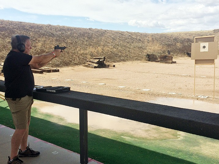Ron Fielder gets some range time in Saturday, Aug. 10, 2019, during the grand opening of the Compass Training Center AZ in Chino Valley. The range is open from 8 a.m. to 4 p.m. Wednesdays through Sundays and can be reached at 928-848-9885. It is located at 3926 Shooting Range Road. (Jason Wheeler/Review)