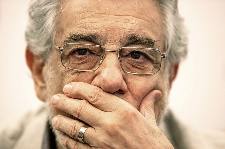 "In this Friday, July 12, 2019, photo, Placido Domingo speaks during a news conference about his upcoming show ""Giovanna d'Arco"" in Madrid, Spain. Eight opera singers and a dancer have told The Associated Press that they were sexually harassed by Domingo, one of the most celebrated and powerful men in opera. The women say the encounters took place over three decades, at venues that included opera companies where he held top managerial positions. (AP Photo/Bernat Armangue)"
