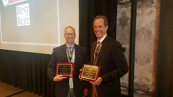 Deputy Yavapai County attorneys Steve Young (left) and Robert Johnson hold up their awards from the Association of Government Attorneys in Capital Litigation conference hosted in Austin, Texas, from Aug. 7 to Aug. 10. (Yavapai County/Courtesy)