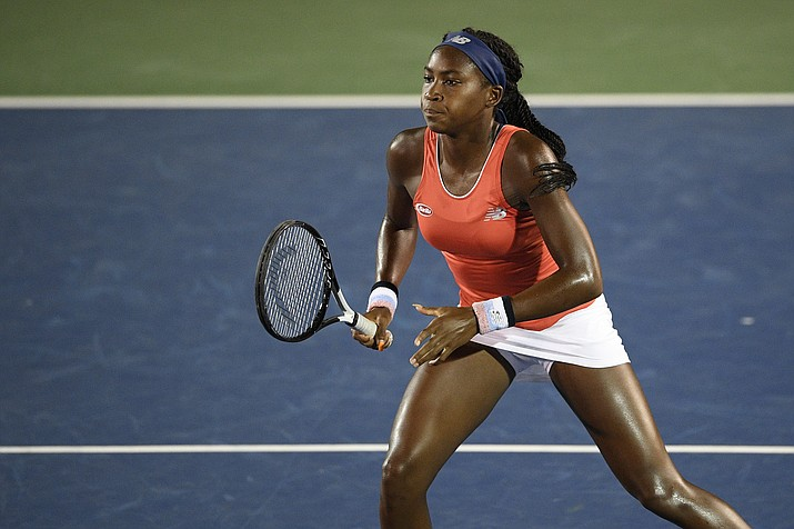 "In this Friday, Aug. 2, 2019, photo, Cori ""Coco"" Gauff stands on the court as she and Catherine McNally played a doubles match against Anna Kalinskaya, of Russia, and Miyu Kato, of Japan, in the Citi Open tennis tournament in Washington. Gauff will get a chance to try for an encore: The 15-year-old from Florida received a wild-card entry Tuesday, Aug. 13, 2019, for the U.S. Open's main draw. It will be Gauff's second Grand Slam tournament. (Nick Wass/AP)"