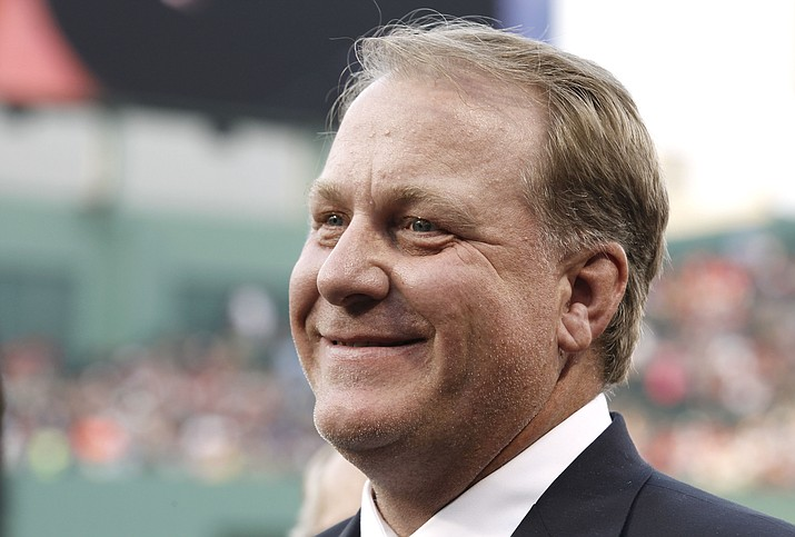 "This Aug. 3, 2012, photo, shows former Boston Red Sox pitcher Curt Schilling smiling after being introduced at Fenway Park in Boston. Schilling says he's thinking about running for Congress in Arizona. Schilling confirmed in an email to The Arizona Republic on Monday, Aug. 12, 2019, that he's considering a run. He declined to say which district he'd run in and wrote that ""the illegal immigration issue is not a joke."" (Winslow Townson/AP, File)"