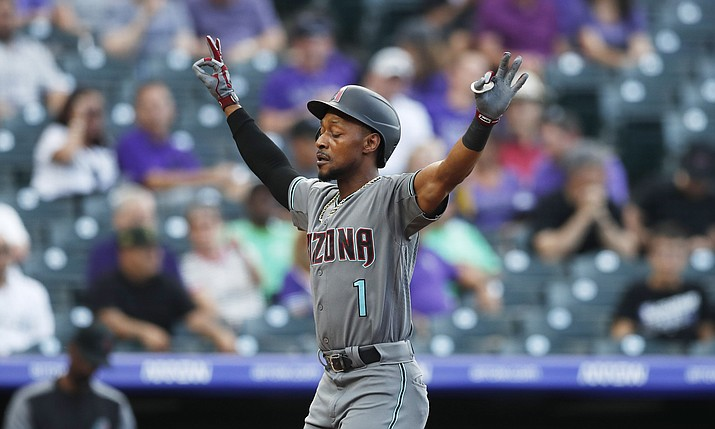 Arizona D-backs' Jarrod Dyson gestures as he crosses home plate after hitting a solo home run off Colorado Rockies starting pitcher Jeff Hoffman to lead off the first inning of a game Tuesday, Aug. 13, 2019, in Denver. (David Zalubowski/AP)