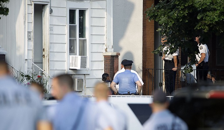 Authorities stand outside a house as they investigate an active shooting situation, Wednesday, Aug. 14, 2019, in the Nicetown neighborhood of Philadelphia. (Matt Rourke/AP)