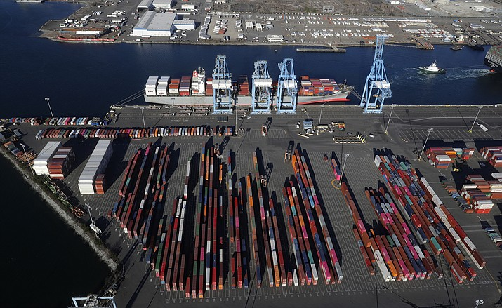 In this March 5, 2019, file photo, cargo containers are staged near cranes at the Port of Tacoma, in Tacoma, Wash. Most economists were already worried that the odds of a recession are rising, and most of the worries stem from the U.S.-China trade war. (AP Photo/Ted S. Warren)