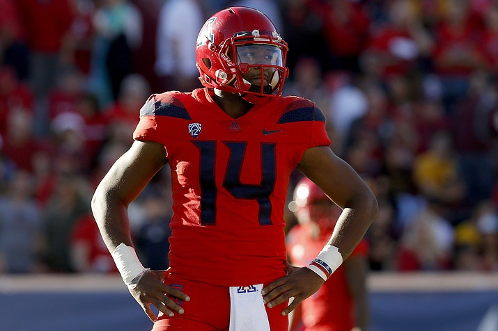 Arizona quarterback Khalil Tate (14) looks on in the second half during a game against Arizona State, Saturday, Nov. 24, 2018, in Tucson, Ariz. Arizona is looking for more consistency after a disappointing first season under coach Kevin Sumlin. The Wildcats return several key players, led by quarterback Khalil Tate and running back J.J. Taylor. (Rick Scuteri/AP)
