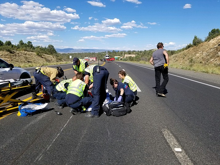 First responders treat an injured motorcyclist on Highway 69 Thursday, Aug. 15. (Prescott Fire Department/Courtesy)