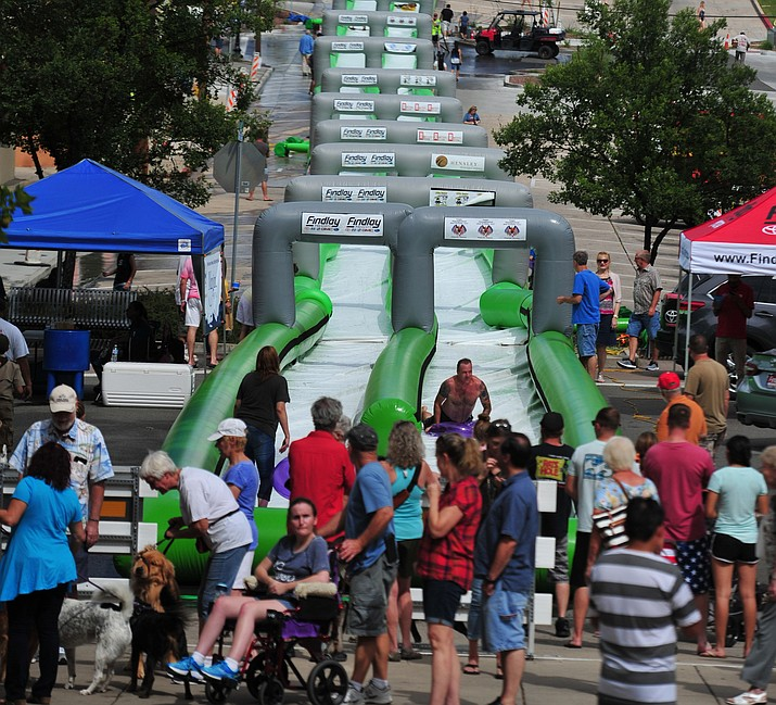 The Northern Arizona Monsoon Festival is being held in downtown Prescott from 12 to 6 p.m. on Saturday, Aug. 17, 2019.  Bring your own inflatable and slide down Union Street on the 675 foot water slide. Admission is $25 for 2 hours and $50 all day. This event is for ages seven and up.  (Les Stukenberg/Courier, file)
