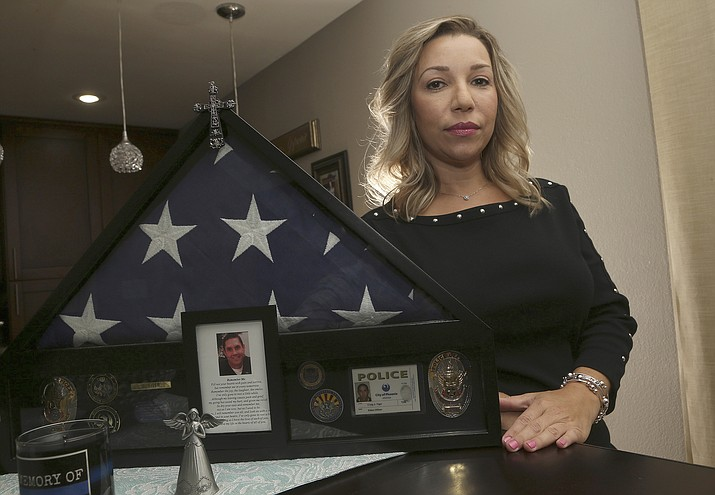 Rebecca Tiger, a former Phoenix police officer, is the widow of Craig Tiger, a Phoenix police officer who committed suicide a few years ago following a fatal shooting he was involved in. Officer Craig Tiger suffered from post-traumatic stress disorder after fatally shooting a man while on duty back in 2012, and took his own life two years later. (AP Photo/Ross D. Franklin)