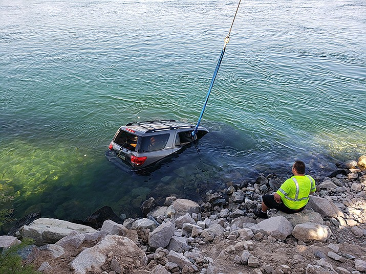 A local tow company responded to the scene where a vehicle was submerged in the Colorado River, and the vehicle was removed. It was found to still be in reverse when pulled from the water. (Photo courtesy of MCSO)