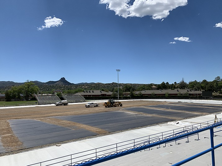 Construction crews work diligently to finish the work on Bill Shepard Field on Wednesday, Aug. 14, 2019, in Prescott. The field is going through a $2 million facelift to put artificial turf down and a new track surface. (Brian M. Bergner Jr./Courier)