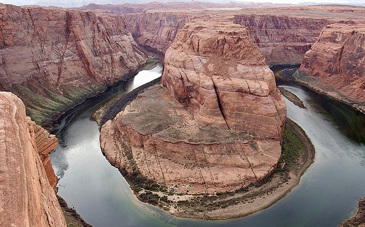 Warmer and drier weather related to the changing climate is challenging Colorado River water managers. (Horseshoe Bend photo by Paul Hermans/Creative Commons tinyurl.com/yxgjgejy )