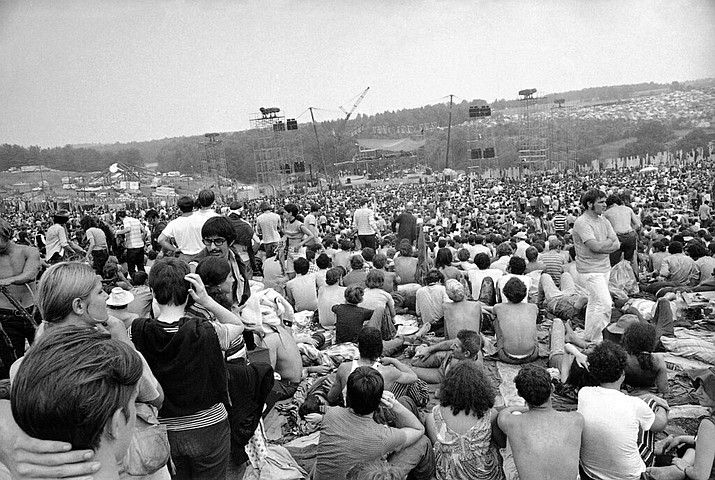 This Aug. 14, 1969 file photo shows a portion of the 400,000 concert goers who attended the Woodstock Music and Arts Festival held on a 600-acre pasture near Bethel, N.Y. Fifty years at Woodstock, the mystical and messy event that became the father of all musical festivals, the entertainment industry is diluted with festivals and events like it, some genre specific, some extremely diverse and others offering experiences in addition to music, ranging from food to art, in order to appeal to wider audiences. (AP Photo/File)
