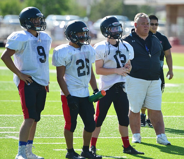 Bradshaw Mountain Head Coach Chuck Moeller and players watch the drills during practice at the high school, Wednesday, August 14, 2019. (Les Stukenberg/Courier)