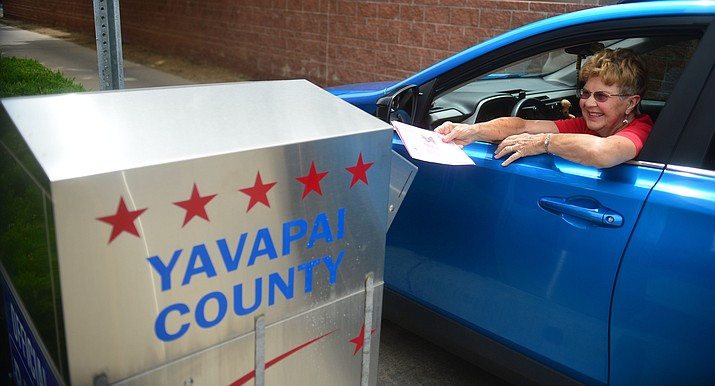 Tina and Clarence Mather drop off their ballots for the City of Prescott council election Friday, August 9, 2019, at the Yavapai County Administration Building.  (Les Stukenberg/Courier)