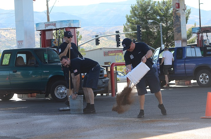 Cottonwood firefighters put down material on a fuel spill at the Maverick gas station on SR89A in Cottonwood on Thursday afternoon. A person spilled gas while pumping, requiring the fire call. VVN/Vyto Starinskas