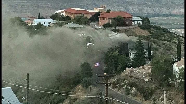 "A house on Jerome's East Avenue, on a ridge known as the ""hogback,"" which runs along SR89A, caught on fire Friday evening. The old Jerome HIgh School is in the background. Photo by Suzy Mound"