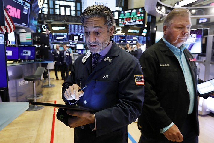 Traders John Romolo, left, and George Ettinger work on the floor of the New York Stock Exchange, Friday, Aug. 16, 2019. Stocks closed higher at the end of a turbulent week. (Richard Drew/AP)