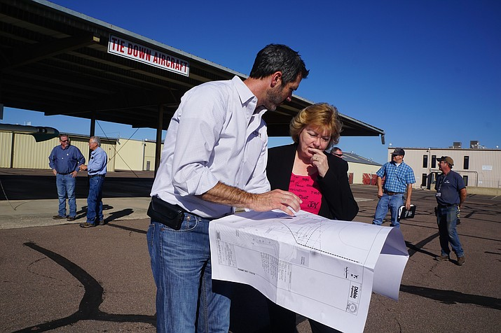 Jason Fann, left, of Fann Contracting talks with Prescott Regional Airport Director Robin Sobotta about plans for the new-terminal construction that is expected to get started this fall. A team from Fann Contracting was on hand at the airport Friday morning, Aug. 16, 2019, to work on last-minute details. (Cindy Barks/Courier)