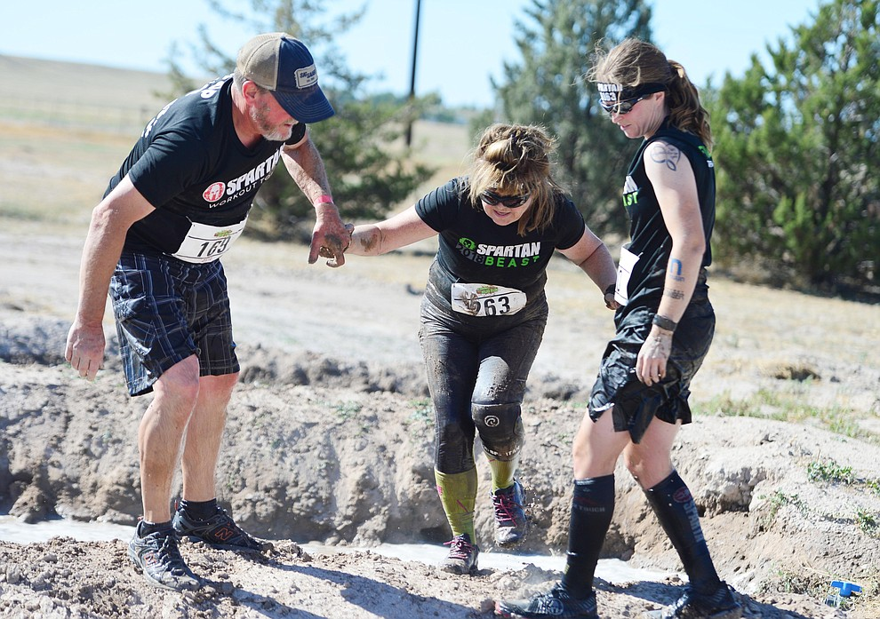 Over 300 people competed in the fourth annual Chino Valley Mud Run at Old Home Manor in Chino Valley Saturday, August 17, 2019. The 5 kilometer race had 22 obstacles that tested each racers endurance and fitness. (Les Stukenberg/Courier)
