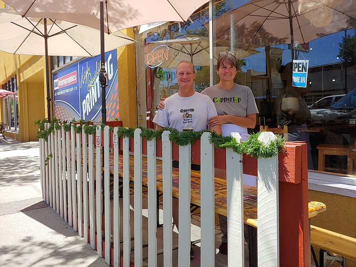 Coppertop Alehouse owner Scott Whitney, seen here on the brewery's outdoor patio with his wife, Marie, received permission from the City of Prescott this past week to serve liquor on the alehouse's South Montezuma Street sidewalk. (Doug Cook/Courier)