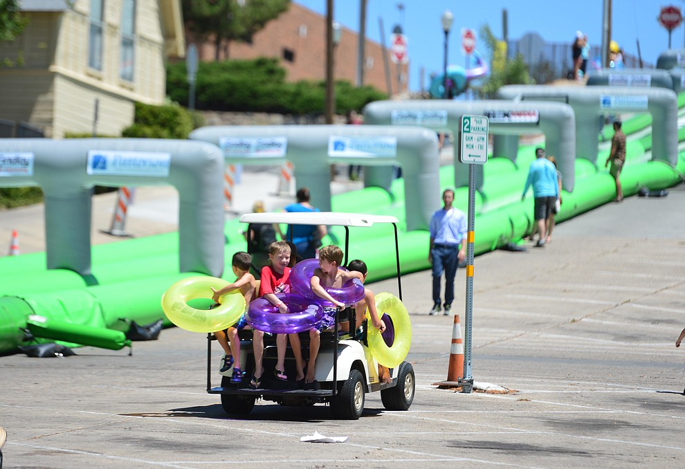 Rides to the top were popular at the annual Monsoon Festival with the water slide that stetches most of the length of Union Street Saturday, August 17, 2019, in downtown Prescott.  (Les Stukenberg/Courier)