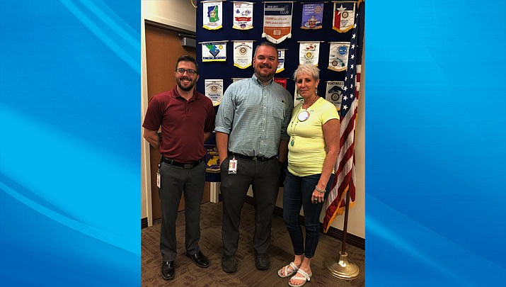 Ben McGlothlin and Scott Kern of Kingman Regional Medical Center are shown above with Kingman Route 66 Rotary Club President Karen Brown at a recent meeting. (Photo courtesy of Kingman Route 66 Rotary Club)