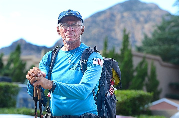 William Shuttleworth, 71, stops for a moment during his pass through the Verde Valley this week. Sedona represented the two-thirds mark of Shuttleworth's 3,400-mile, cross-country walk to raise awareness for America's veterans. Shuttleworth will be speaking at the Hassayampa Inn in Prescott at 4 p.m. on Monday, August 19, 2019. (Vyto Starinskas, Verde Independent)